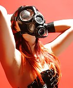 Mistress in lace latex garb and gas mask