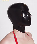 Latex brunette gets cuffed and hooded