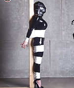 Latex brunette wrapped and hooded