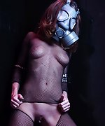 Hottie in a gas mask rips off her fishnet cat suit