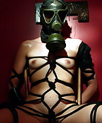 Gasmasked and tied with rope