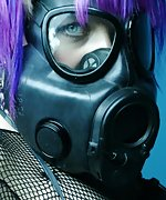 Gothic femme in a gas mask and a fishnet body suit