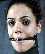 Brunette gets stripped, cuffed, gagged and dildoed