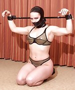 Latex beauty tied, hooded and trained