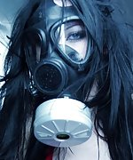Brunette gagged and bound with a gas mask