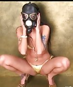 Gas mask girl brings herself to an intense orgasm