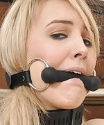 Blond slut cuffed with a spreader bar and bit-gagged