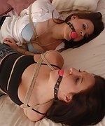 Two girls are bound and gagged tightly together