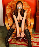 Kinky brunette is chained and tape-gagged