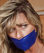 Pretty milf gets roped and tape-gagged
