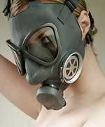Blonde in latex stockings, latex gloves and gasmask