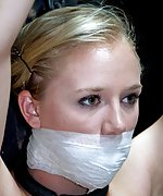 Pretty naked blond is cuffed, gagged, and caned