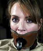 Bound with straightjacket, gagged, dildoed, plugged