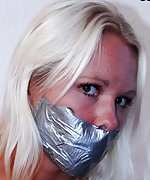 Blondie gets tightly roped and tape-gagged