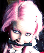 Pink-haired beauty roped and bit-gagged