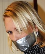 Secretary tied to a chair and tape-gagged