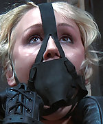 Blond slut in humiliating tight bondage