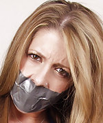 Beauty gets roped, tape-gagged and exposed