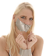 Blonde tied with duct tape and tape-gagged