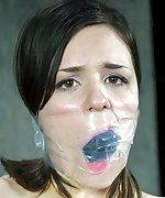 Brunette undressed, roped, cuffed, tightly gagged